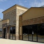 sandblasting-brick-strip-mall-building