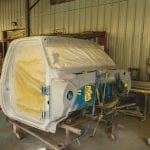 Picture of autobody in middle of repairs